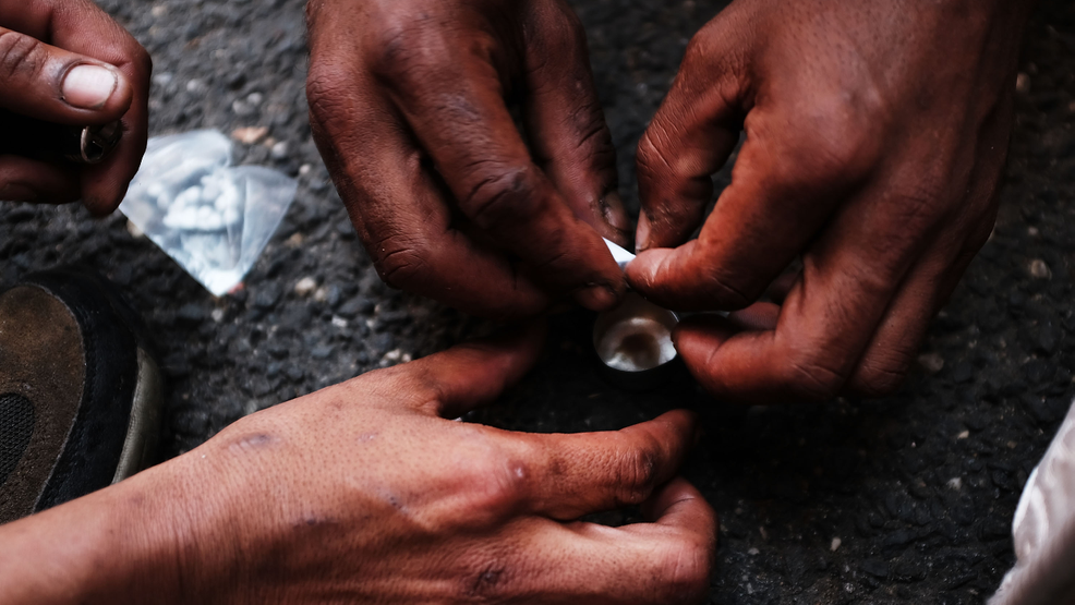 FILE PHOTO - Heroin users prepare to shoot up on the street. (Photo by Spencer Platt/Getty Images)