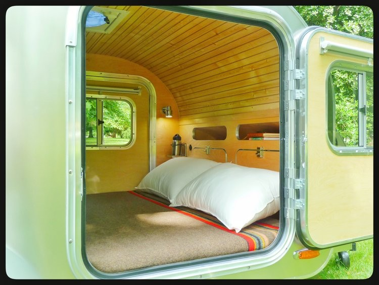 The Inside Of High Camp Trailer Features Storage LED Lighting And A Queen Bed