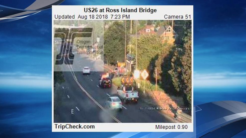 Police respond to crash on Hwy 26 at the east end of the Ross Island