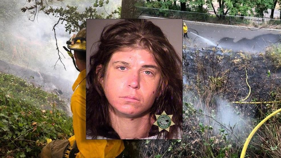 Warrant issued for woman accused of setting fire to bluffs